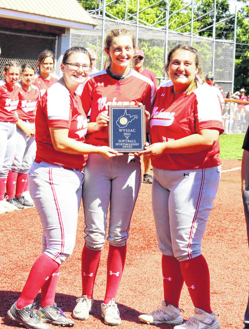Wahama seniors, from left, Victoria VanMatre, Emma Gibbs and Deborah Miller accept the Class A Sportsmanship award, following the Lady Falcons' 5-3 victory in the state championship on Wednesday at Little Creek Park in South Charleston, W.Va.