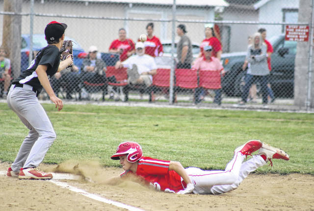 Wahama freshman Bryce Zuspan dives back into first base, during the White Falcons' 18-1 victory on Tuesday at Claflin Stadium in Mason, W.Va.