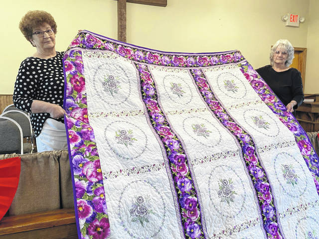 Barbara Zuspan, left, and Evelyn Roush, are pictured with one of two quilts purchased by the late Corena Barnitz, to be auctioned at the Bend Area Gospel Jubilee next week at the Jackson County Junior Fairgrounds. Zuspan made the quilts while serving as caregiver for Barnitz.