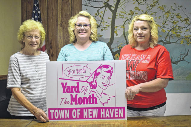 Town of New Haven office workers Shelby Duncan, Kelly Gilland, and Teresa Gibbs, from left, are pictured with the signs that will be placed on the properties of Yard of the Month winners. The new program will begin Monday for June, and continue during the months of July and August.