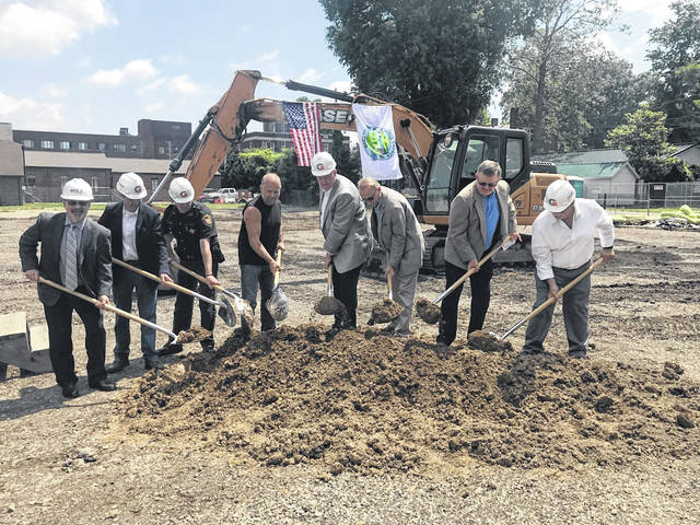 """Pictured turning dirt at Friday's groundbreaking for the new Gallia County Jail, from left, Greg Galieti, director of architecture for DLZ, Jamie Brundrett, senior project manager for Granger, Sheriff Matt Champlin, Commissioners Q. Jay Stapleton, Harold Montgomery, former commissioners Dr. David K. Smith, Brent """"Coach"""" Saunders, Commissioner M. Eugene Greene."""