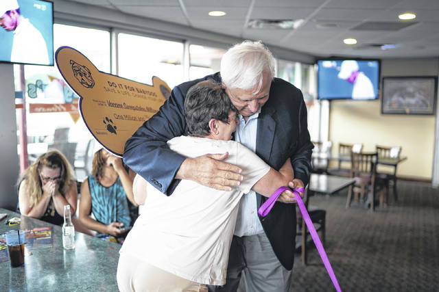 """Sharon Turner of Morgantown hugs Gov. Jim Justice after learning she is the latest $1 million winner in the """"Do it for Babydog: Save a life, Change your life"""" Vaccination Sweepstakes."""