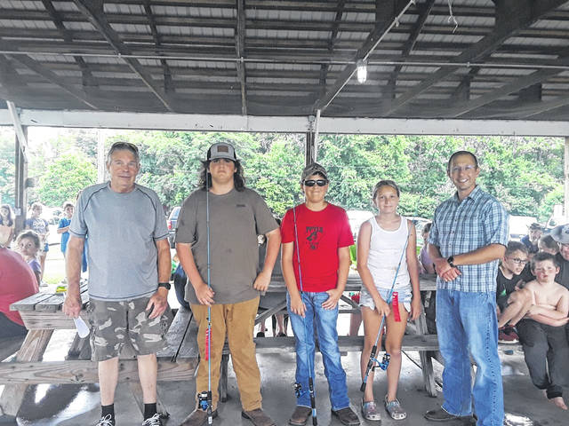 """Pictured with Greg Fowler, left, and Jonathan Pinson, right, are the winners for ages 11-15: Shortest – Isiah Brown-3""""; Longest – Andrew Parker-25 ½""""; and Most caught – Lakin Bush-32."""