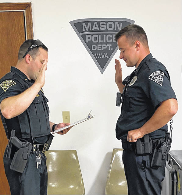 Calyon Turner, right, is shown as he is being sworn in to the position of police patrolman by Chief Colton McKinney. Turner was hired during the most recent council meeting.