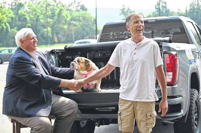 William Harris, Clendenin, is presented with a new custom pickup from Gov. Jim Justice and Babydog on Wednesday.
