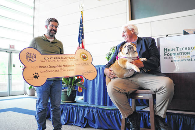 """Timothy Jackson, Bridgeport, was this week's winner of $1 million in the """"Do it for Babydog: Save a life, Change your life"""" Vaccination Sweepstakes. Also pictured are Gov. Jim Justice and Babydog."""