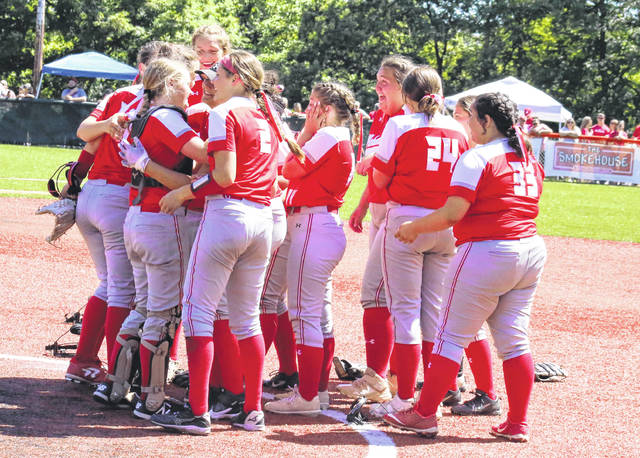 Members of the Wahama softball team celebrate the Class A state championship last week on Craft Field at Little Creek Park in South Charleston, W.Va.