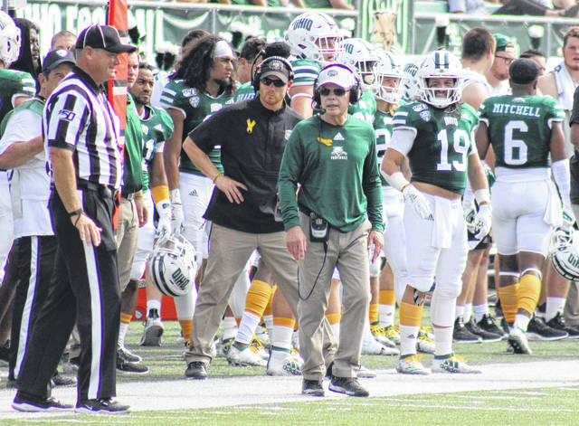Ohio head coach Frank Solich talks with an official, during the Bobcats' non-conference game on Sept. 21, 2019, at Peden Stadium in Athens, Ohio.