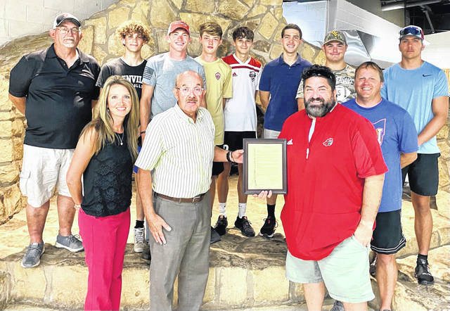 Pictured front row, from left, City Clerk Amber Tatterson and Mayor Brian Billings present a proclamation honoring the state champion PPHS Boy's Track Team to Coaches Matt Cottrill and Chip Wood; pictured back row, from left, Throwing Coach Tracy McCormick, team members Brayden Randolph, Preston Taylor, Cooper Tatterson, Ian Wood, Austin Weikle, West Baker and Cody Schultz.