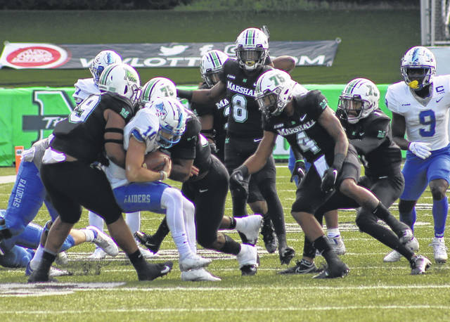 Marshall defenders Jamare Edwards (99) and Kobe Cumberlander bring down Middle Tennessee State quarterback Asher O'Hara during the first quarter a Nov. 14, 2020, Conference USA football game at Joan C. Edwards Stadium in Huntington, W.Va.