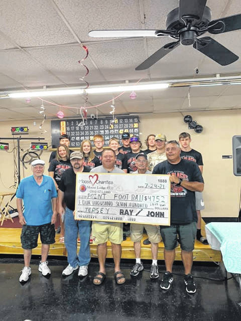 The Point Pleasant Moose Lodge #731 helped celebrate 100 years of Point Pleasant High School football by co-sponsoring a fundraiser over the weekend. Pictured are players, coaches and members of the Moose Lodge.