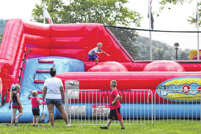 These children enjoy an inflatable obstacle course at River Rec on Friday.