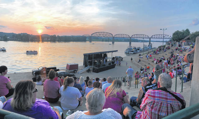Point Pleasant Riverfront Park begins to fill with people on Sunday ahead of a performance from Flatrock Revival and a fireworks show over the Ohio River.