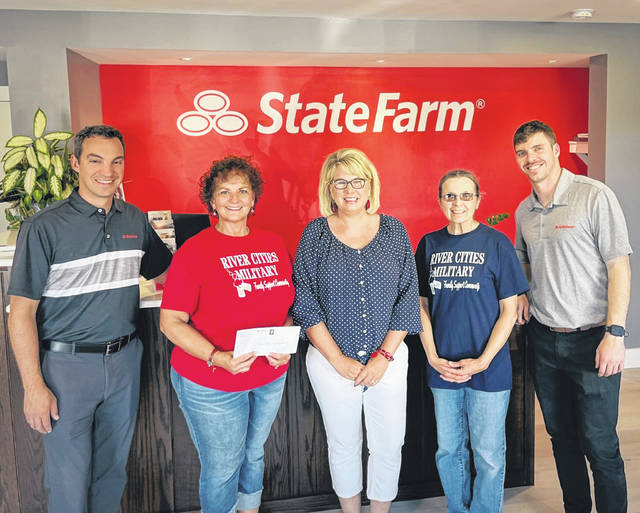 Pictured from left, Beau Sang from Beau Sang State Farm, Lou Ann Shawver, Lorna Atkins and Lia Bartee from River Cities Military Family Support Community and Wade Jarrell from Beau Sang State Farm.