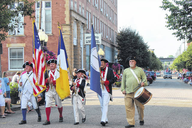 The Sons of the American Revolution present the colors in the Liberty Fest Parade on Sunday.