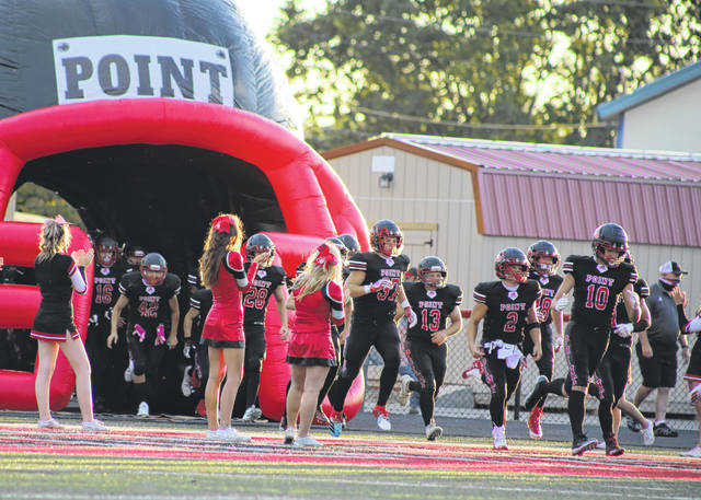 Pictured are members of last year's Point Pleasant High School Big Blacks football team rushing on to the field. The Big Blacks began their season at home against Greenbrier East last night.