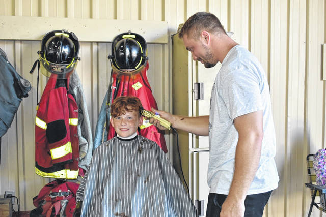 Colton Neal treated the young men who attended the Back-to-School Bash in New Haven Sunday to free haircuts. Children received school supplies, snacks, and even food to take home at the event.