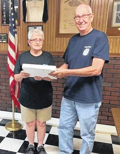 The Stewart-Johnson V.F.W. Post 9926 of Mason recently made a monetary donation, as well as the donation of an American Flag, to the Mason United Methodist Church. Pictured accepting the donation from Commander Ronie Wheeler, right, is Kathy VanMeter. The church will hold it's annual Community Ice Cream Social on Saturday from 4 to 7 p.m. There will be homemade ice cream, desserts, and hotdogs.