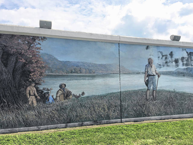 The murals at Riverfront Park in Point Pleasant include a depiction of President George Washington surveying Mason County.
