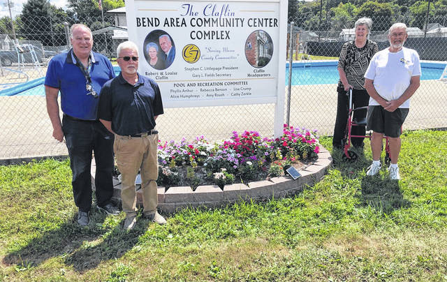 Heating and cooling units, as well as chemicals, paint, concrete and a chlorine pump were provided this year at the Bend Area Community Center Complex in New Haven by the Robert and Louise Claflin Foundation. Pictured, from left, are Stephen Littlepage, foundation president; Gary Fields, foundation secretary; Phyllis Arthur, chairperson of the municipal swimming pool committee; and Roy Dale Grimm, who began the grant process for the heating and cooling units.