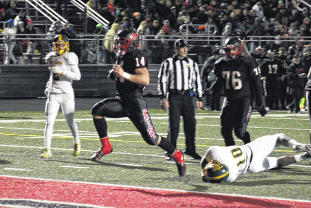 Point Pleasant's then senior Cody Mitchell (14) runs into the endzone for one of his four touchdowns in a 2015 contest with Huntington High School — the program secured its third state semifinal appearance in school history with a 49-0 victory.