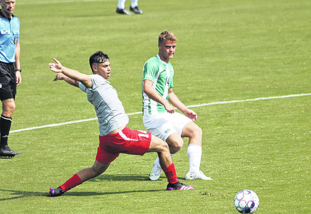 Rio Grande's Diego Martinez steps in front of a pass intended for Marshall's Adam Lubell during Friday's exhibition men's soccer match at Davis Field in Rio Grande, Ohio.