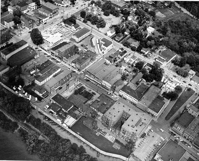 """This undated aerial photo shows a section of downtown Point Pleasant between Fourth and Sixth streets. The construction of the Mason County Courthouse is visible in the upper lefthand corner. The """"new"""" courthouse was built in 1956."""