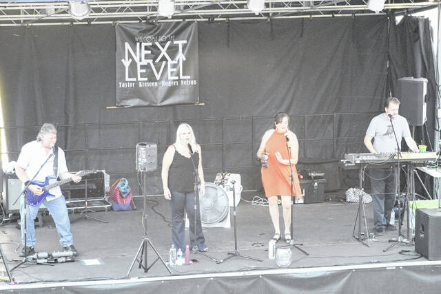 """Next Level will be performing Saturday evening at the Mason park as part of the town's """"Music in the Park"""" series. The group consists of band members Rich Rogers, Jill Nelson, Barry Taylor and B.J. Kreseen, pictured performing this summer in Point Pleasant."""