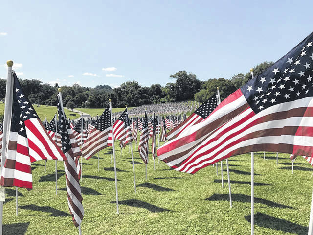 Opportunities to observe the 20th anniversary of 9/11 are planned for Mason County, including a ceremony on Saturday at Riverfront Park. Pictured are rows of American flags at the Healing Field at Spring Hill Cemetery in Huntington, marking the anniversary of the attacks during a previous year.
