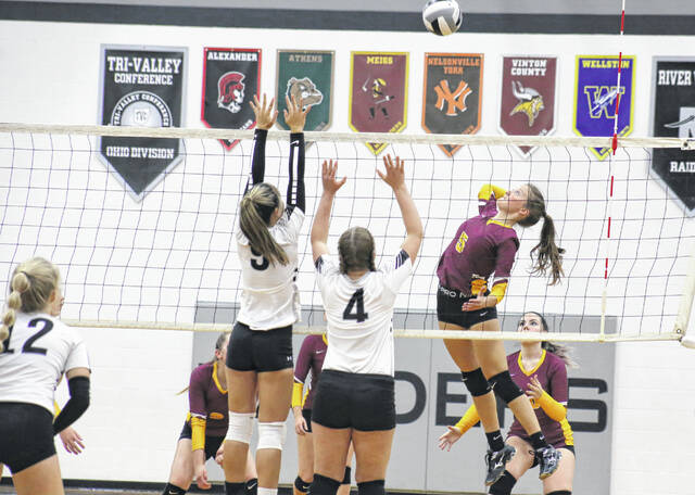 Meigs sophomore E.J. Anderson (5) leaps for a spike attempt during Game 1 of Thursday night's TVC Ohio volleyball match against River Valley in Bidwell, Ohio.