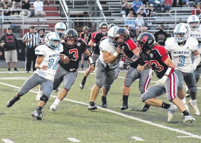 Point Pleasant defenders Tyler Hinzman (3), Colby Price (50) and Zander Watson (23) all close in on Mingo Central running back Kaedon Bowling (30) during a first half run Friday night at OVB Field in Point Pleasant, W.Va.