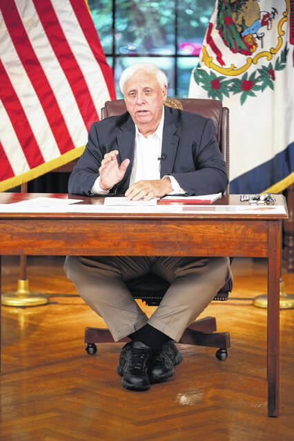 Gov. Jim Justice, pictured, encouraged all residents who qualify for a booster shot to get one during his Monday briefing in Charleston.