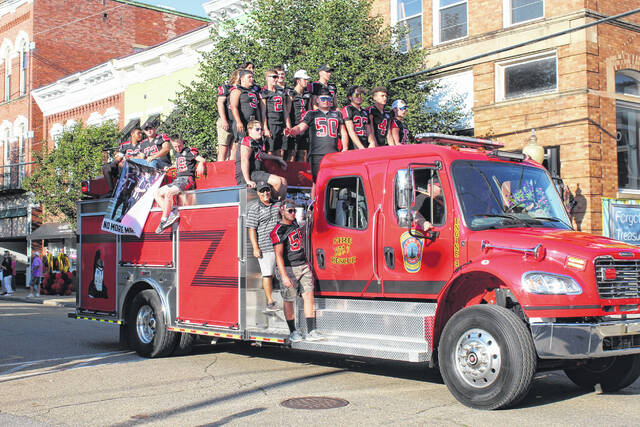 On Thursday, supporters of Point Pleasant High School lined Main Street to note this week's 100 Years of Football celebration at PPHS. Pictured are members of the varsity football team being escorted by the Point Pleasant Fire Department via its Big Blacks Edition truck. More from the parade inside and online at www.mydailyregister.com. Following the parade, supporters gathered at a special pep rally held at the high school.
