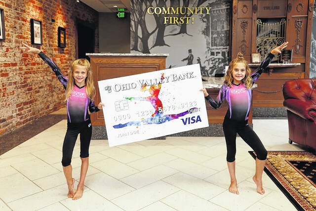 Gymnasts pictured with the card design are Ella Grant and Bekah Circle.