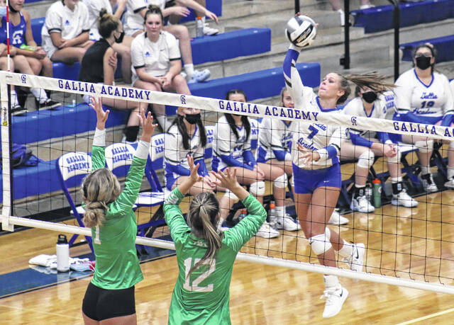 Gallia Academy junior Callie Wilson (7) hits a spike attempt during Game 1 of Tuesday night's OVC volleyball match against Fairland in Centenary, Ohio.