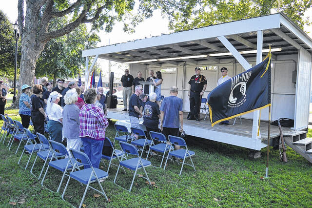 Pictured is a scene from a previous observance of National Prisoners of War and Missing in Action Recognition Day. This year's ceremony is at 10 a.m. this Friday at Gallipolis City Park. Pictured from a past observance, a member of VFW Post 4464 stands by the ceremonial POW and MIA Empty Chair and Table. Friday is National Prisoners of War and Missing in Action Recognition Day with a special service planned at Gallipolis City Park.