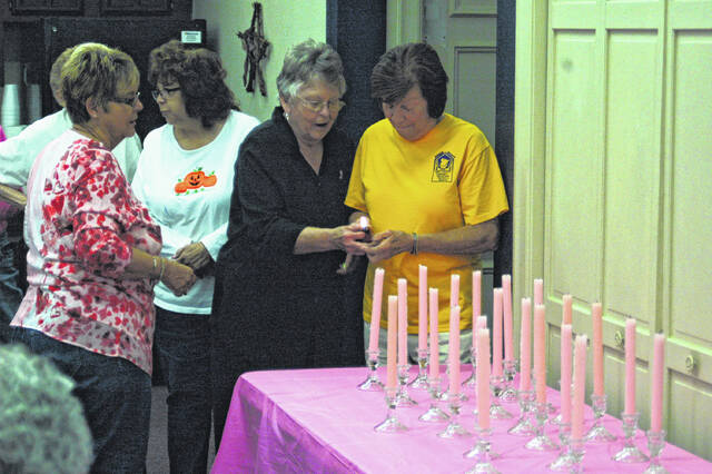"""Pictured is a scene from a previous Mason County CEOS Breast Cancer Awareness Ceremony. A wreath hanging and """"In Memory Table"""" will return to the event held entirely outdoors this year at the Mason County Library in Point Pleasant this Monday."""
