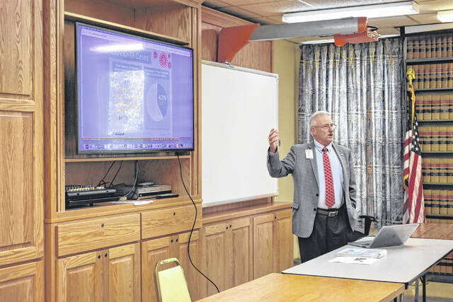 Holzer Hospital CEO, Michael Canady, discusses COVID-19 trends during a presentation at the Gallia County Commission meeting this week attended by various office holders and courthouse staff.
