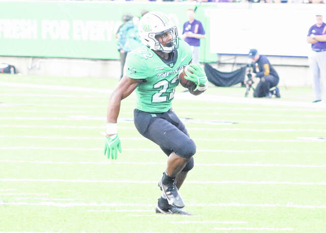Marshall running back Rasheen Ali (22) finds a hole in the ECU defense during a football game at Joan C. Edwards Stadium Saturday evening in Huntington, W.Va.