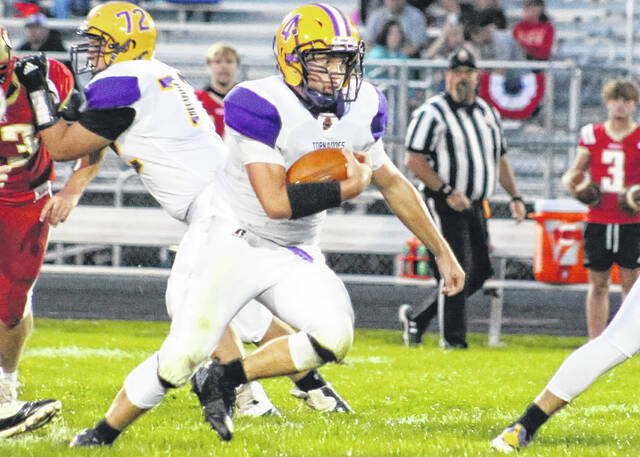 Logan Hensler (4) searches for a hole in the South Gallia defense during a game in Mercerville, Ohio Friday evening.