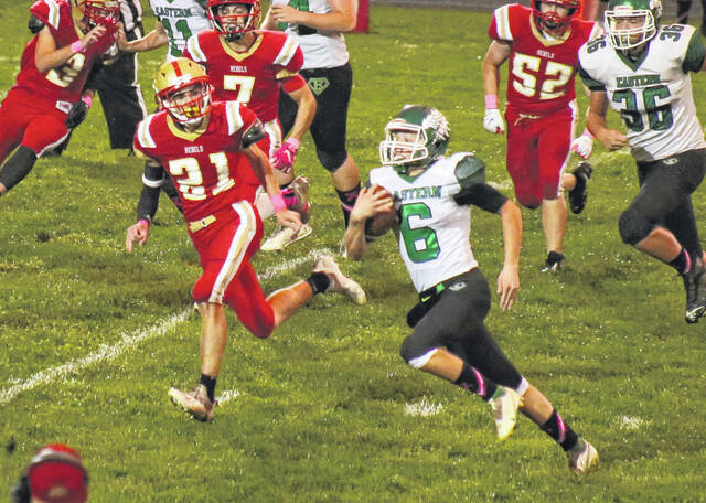 Eastern senior Bryce Newland (6) picks up yardage while being chased by the South Gallia defense Friday night during a TVC Hocking football contest in Mercerville, Ohio.