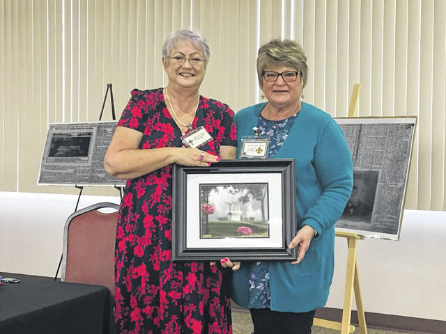 Bev Jeffers, Our House Tavern Directory, presented a framed photo of the Gallipolis City Park, the site of the first settlement in Gallia County by the French 500 in 1790, that included Dr. Antoine Saugrain and family to Char Waughtel as a thank you.