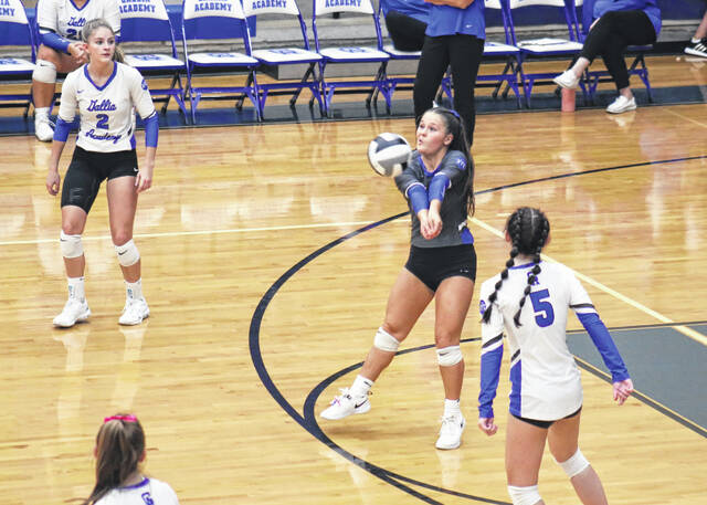 Gallia Academy junior Jenna Harrison, middle, bumps a ball in the air during Thursday night's OVC volleyball contest against Rock Hill in Centenary, Ohio.