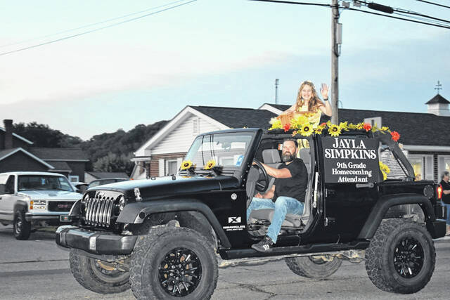 Freshman class attendant Jayla Simpkins is pictured as she rides along the parade route in her decorated Jeep.