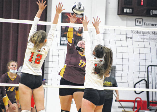Meigs senior Meredith Cremeans gets the ball over Lady Tiger defenders in a volleyball game against Marietta Monday evening in Pomeroy, Ohio.