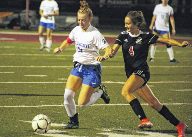 Gallia Academy senior Kyrsten Sanders (21) keeps the ball away from Point Pleasant freshman Bella Tolliver (4) during a soccer game Tuesday at Ohio Valley Bank Field in Point Pleasant, W. Va.