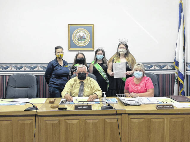 Mason County Commissioners Sam Nibert and Tracy Doolittle, pictured seated, welcomed 4-H royalty to recognize 4-H Week. Pictured back row, from left, are Lorrie Wright from WVU Extension, Young Miss 4-H Kinzy Arbogast, Junior Miss 4-H Emma Deal and Miss 4-H Autumn Baker.