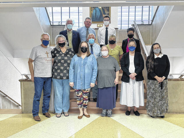 Pictured are representatives from the Mason County Commission alongside representatives from Bend Area Food Pantry, Crosslight of Hope and Kitchen of Blessing Food Pantry.