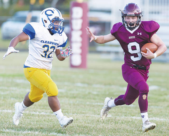 Dukes' quarterback Mason Wright scrambles for yardage Friday during a 44-6 loss to the Clearview Clippers, which puts Wellington's record at 0-4.