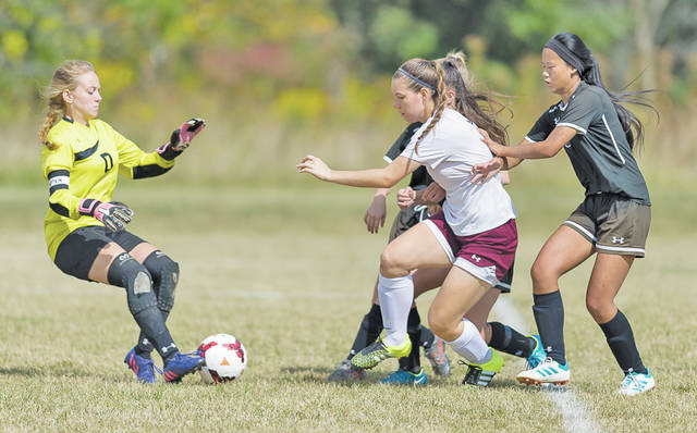 Keystone keeper Cassandra Harant comes out to make the save against Wellington's Victoria Horoschak.